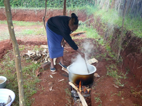 Meal preparation in Ziwa, Kenya. Note the color of the water in basin to the left